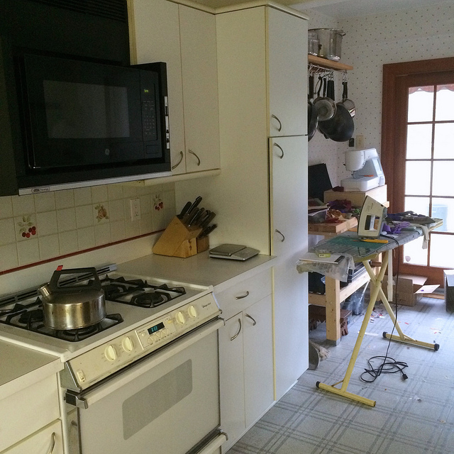 the sewing station occupies an area of the kitchen that was designed to house a kitchen table just in front of the sliding double doors that lead to the - Kitchen Table Sewing